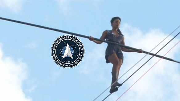 A tightrope walker in Paris plus US Space Force logo - Unknown Origin but for the logo